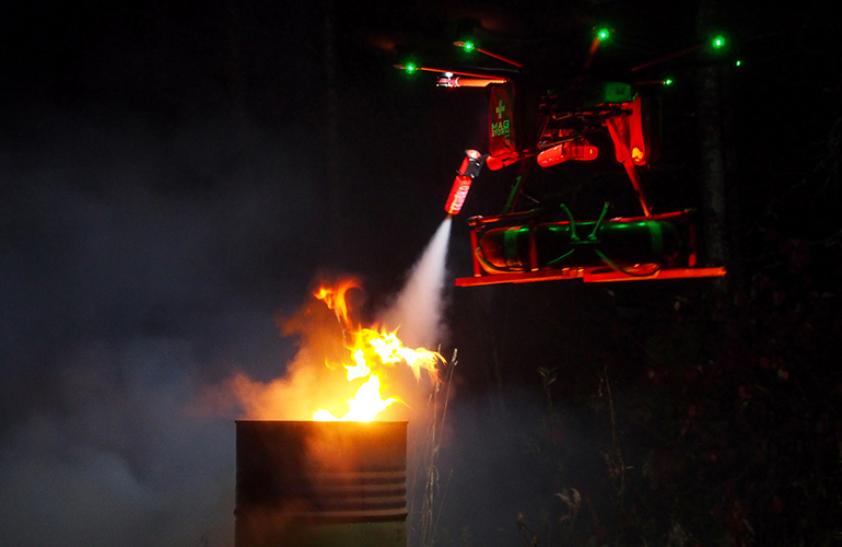 Flying robot extinguishing small fire.