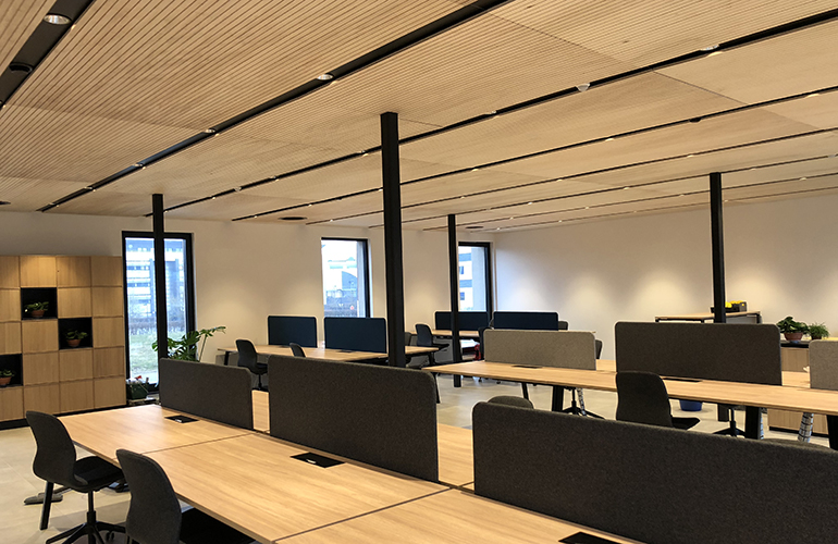 Inside the newly built office, wooden desks and chairs