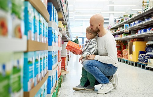 Father and son in shopping aisle